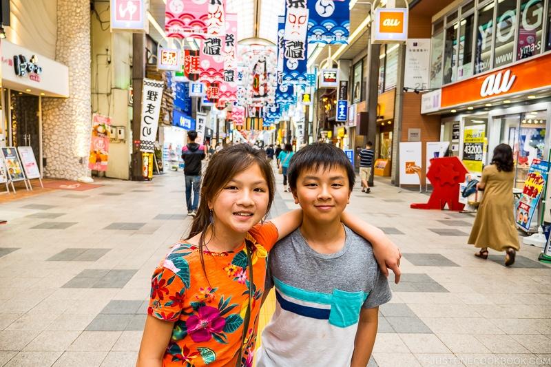 two children at Tanukikoji Shopping Street