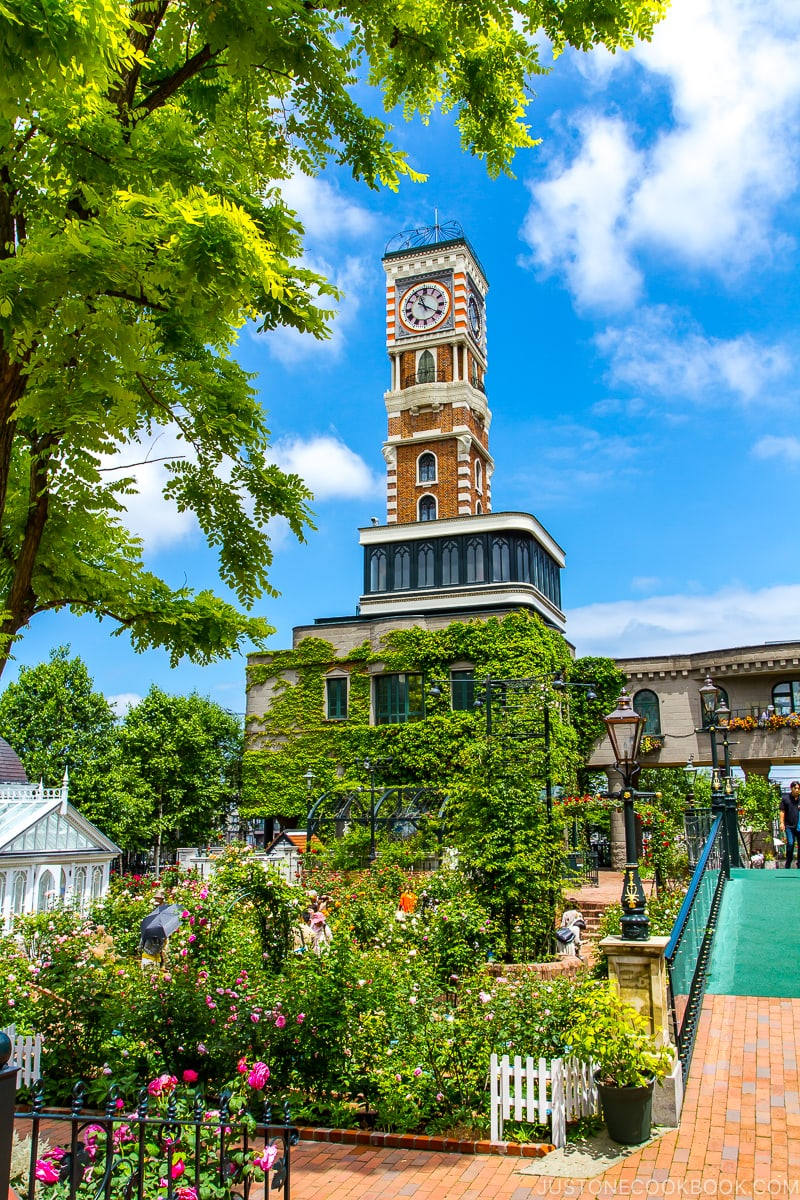 flower garden and clock tower at Ishiya Shiroikoibito Park