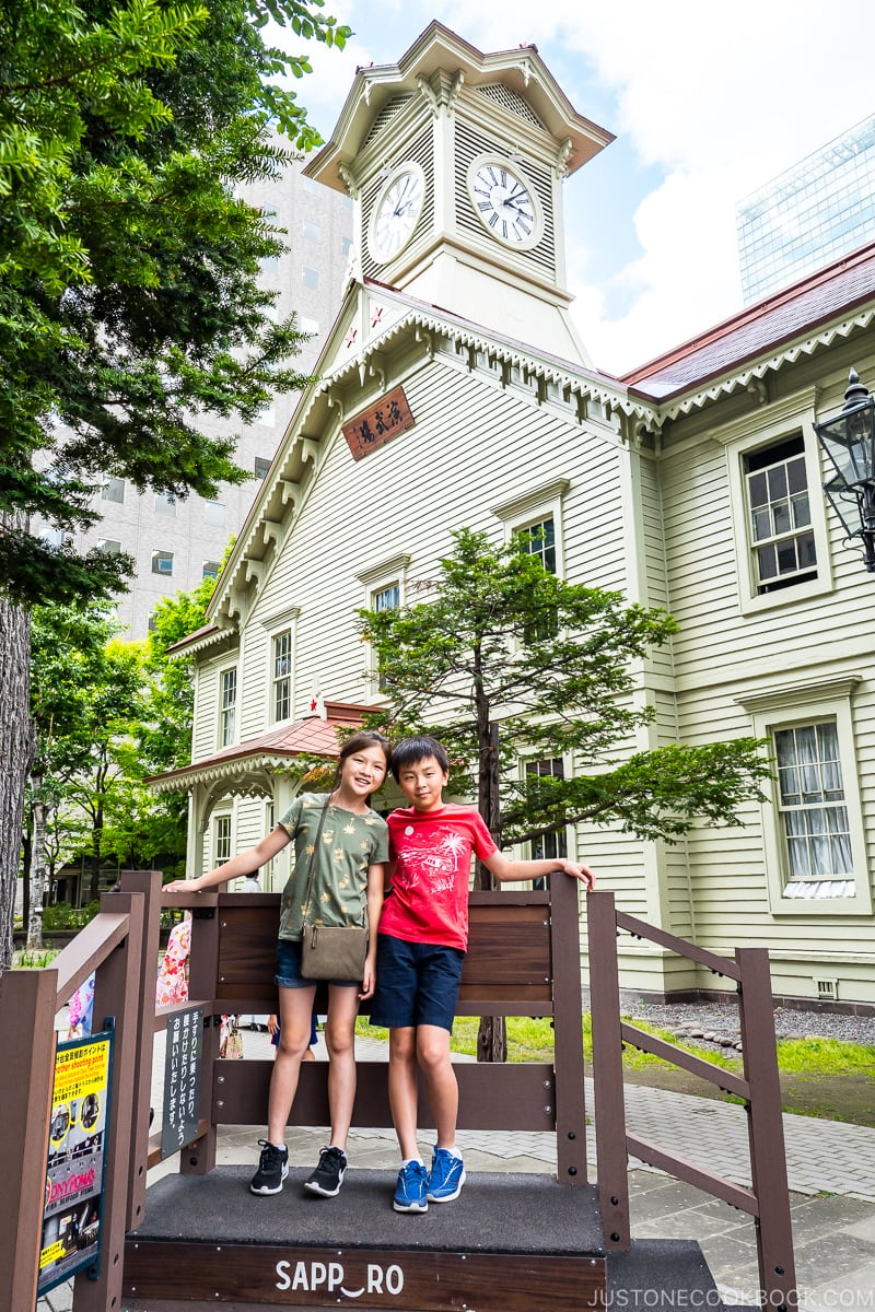 two children in front of Sapporo Clock Tower