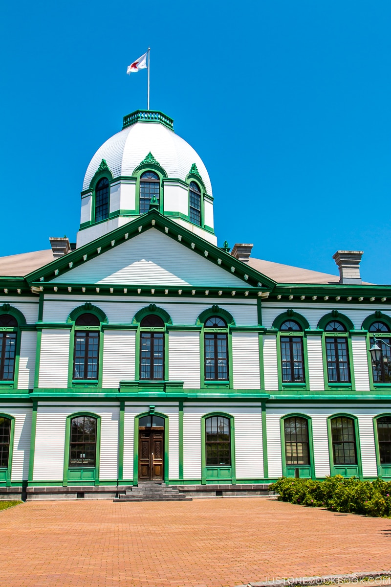 a white three story building at Historical Village of Hokkaido