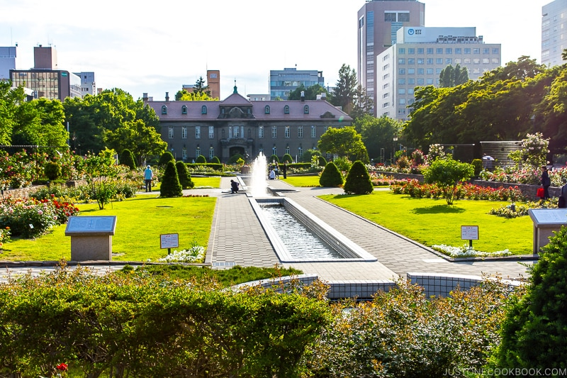 a fountain and park in front of Sapporo Archives Museum