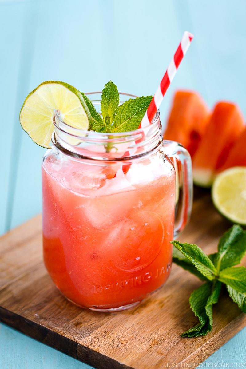 A glass jar containing homemade watermelon juice.