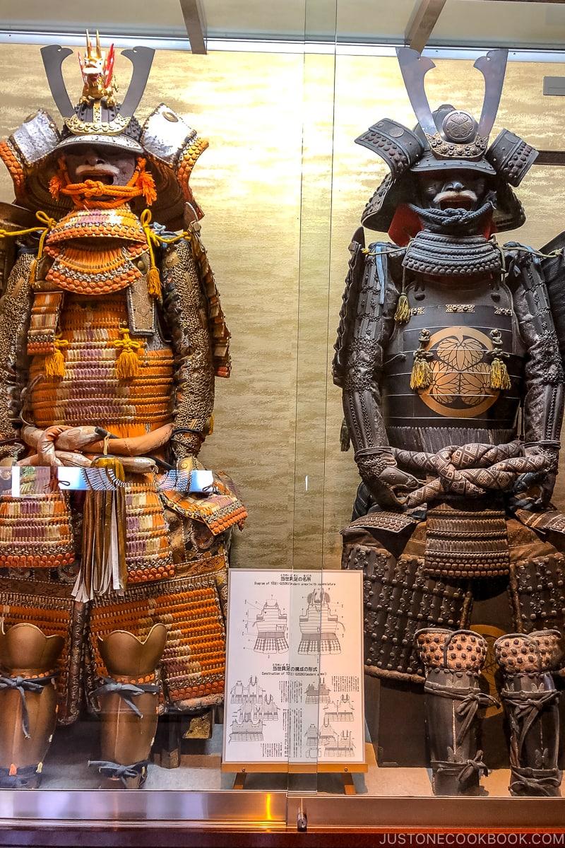 samurai armor in a glass display case
