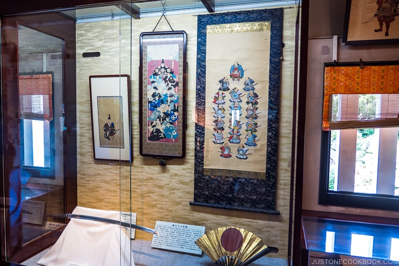 art scroll and knife in a display case