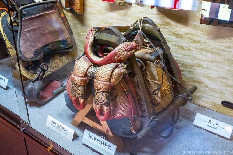 antique saddle in a display case
