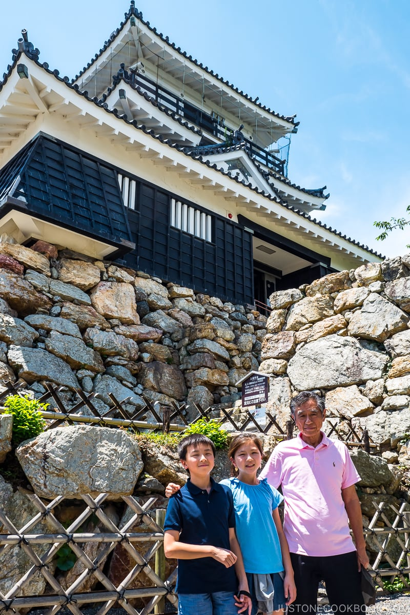 two children and an older man in front of Hamamatsu Castle