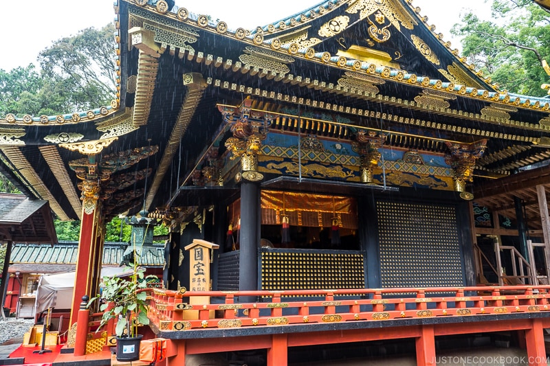 main red, gold, and black shrine building