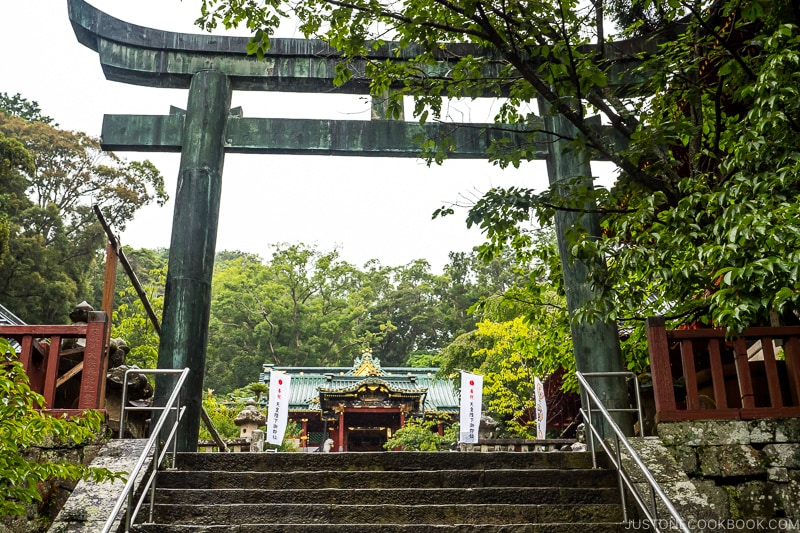 stone torii gate with a shrine in the back