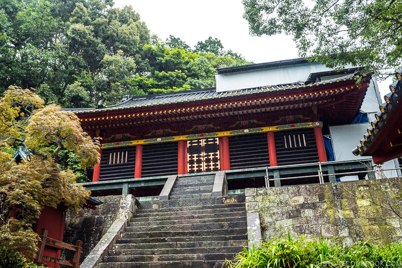 steps leading up to a red and black shrine building