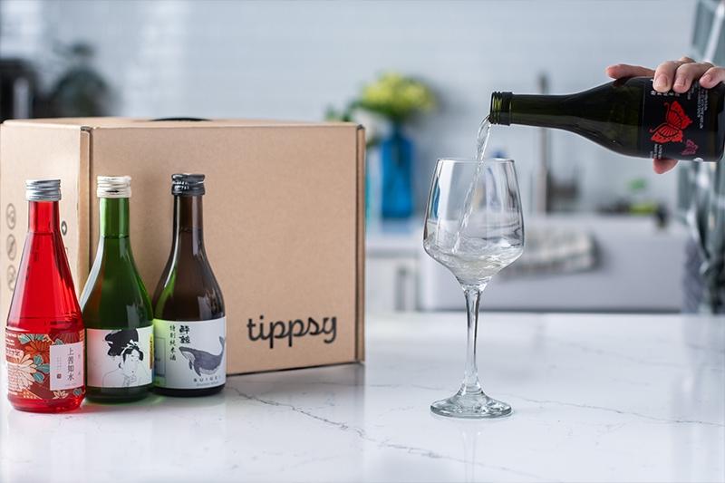 lifestyle image of sake pouring with Tippsy sake box