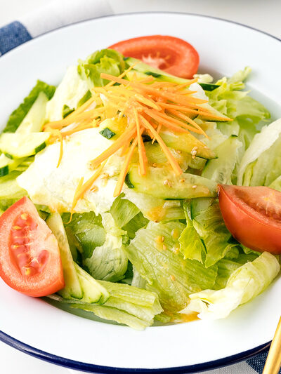 A plate containing salad drizzled with Ume Miso Dressing.