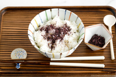 A rice bowl containing steamed rice topped with Yukari Shiso Rice Seasoning.