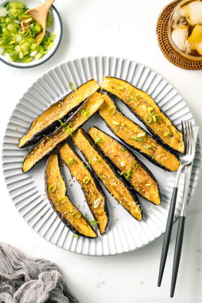 A white plate containing Miso Glazed Eggplant.