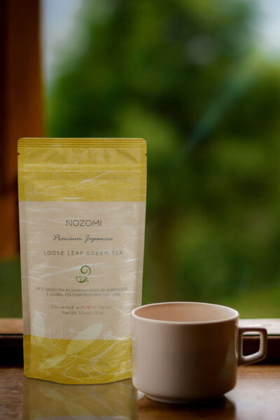 Japanese Green Tea Company tea bag next to a cup of green tea